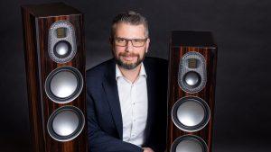 Man between two speakers